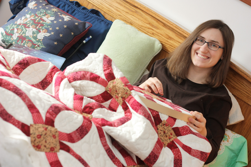 Sarah hand-quilting a Double Wedding Ring quilt