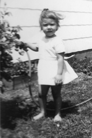 Deb watering Granny's rosebushes at our first house on Rt 58