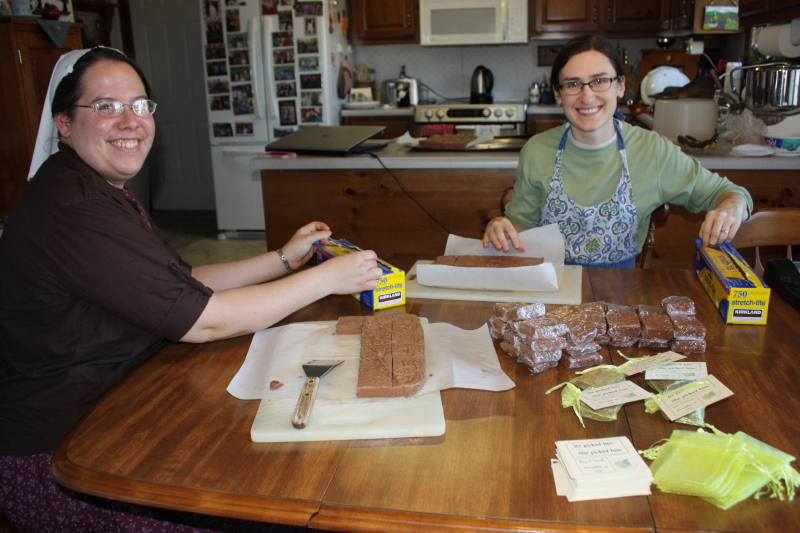 Friends enjoying fellowship and wrapping fudge