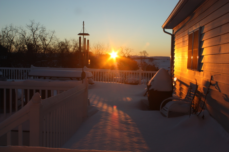 Snowy deck scene at sunrise