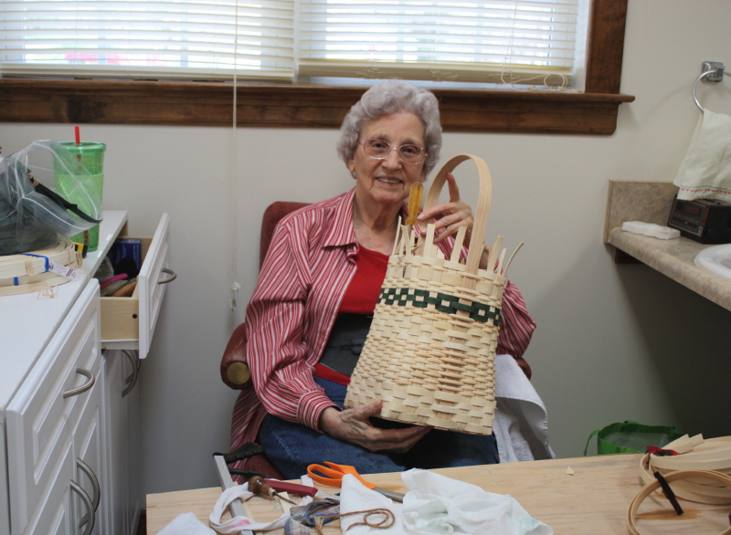 Granny making a Mustard Basket for a customer