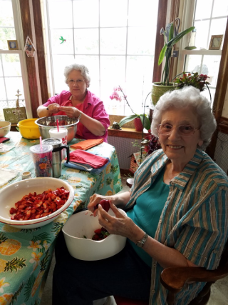 Granny hulling strawberries