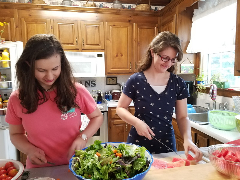 Emma and Abby helping with the meal the day before