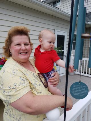 Grandma Victoria holding Matthew
