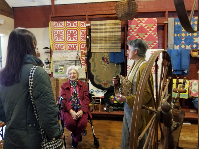 discussing the quilts and baskets