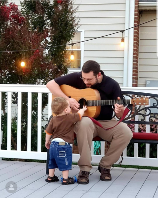 Uncle Jonathan playing guitar