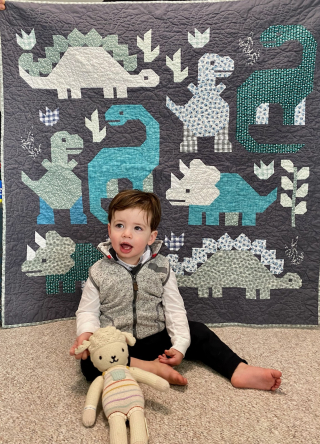 grandson with dinosaur quilt