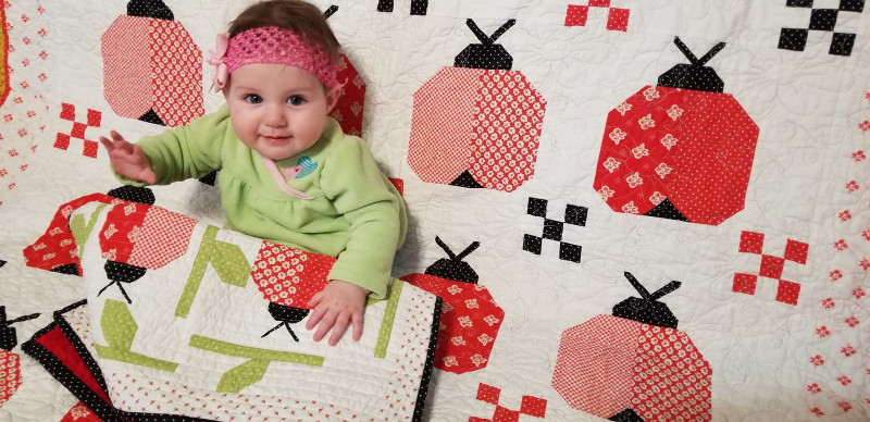 little punkin with her ladybug quilt